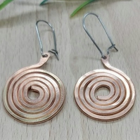 Spiral copper earrings.
