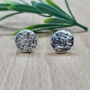 Reticulated sterling silver ear studs.