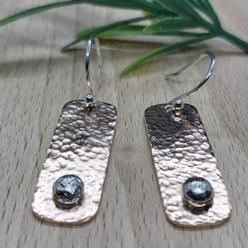 Copper and silver drop earrings.