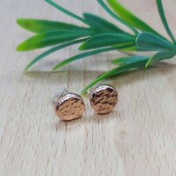 Copper stud earrings with a hammered finish.