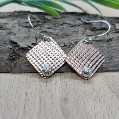 Copper and silver square drop earrings.