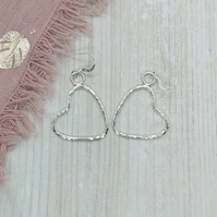 Sterling silver heart earrings.