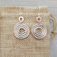 Copper spiral earrings.