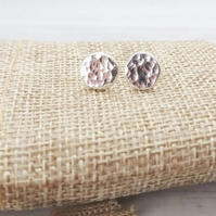 Sterling silver hammered handmade stud earrings.