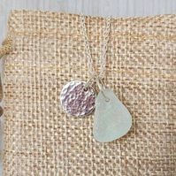 Sterling silver and sea glass pendant necklace.