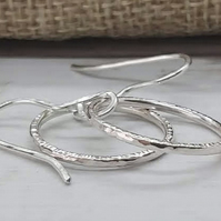 Sterling silver hoop earrings.