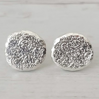 Sterling silver stud earrings.