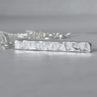Sterling silver bar pendant necklace.