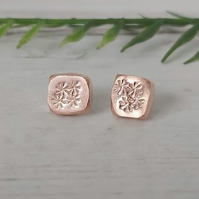 Copper stud earrings.