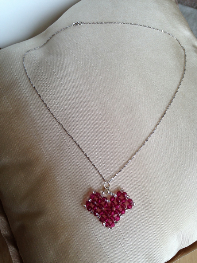 Deep pink beaded heart on a sterling silver chain