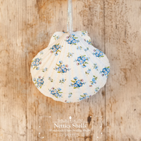 Hanging Forget me Not Decoration on Giant Scallop Shell by Netties Shells
