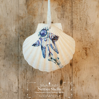 Hanging Spaceman Decoration on a Giant Scallop Shell by Netties Shells