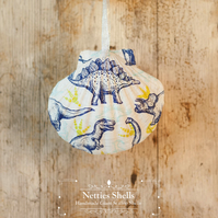 Hanging Dinosaur Decoration on a Giant Scallop Shell by Netties Shells