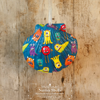 Hanging Blue Monster Decoration on a Giant Scallop Shell by Netties Shells
