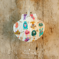 Hanging White Monster Decoration on a Giant Scallop Shell by Netties Shells