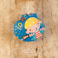 Hanging Pirate Decoration on a Giant Scallop Shell by Netties Shells