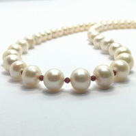 White Freshwater Near Round Pearls with Faceted Garnet