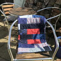 Red and blue nursery quilt