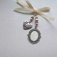 "Pretty Bouquet Charm Oval Silver Locket with an ""always in my heart"" charm"