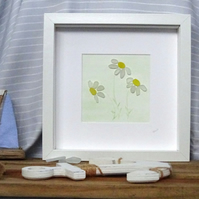 Natural sea glass framed picture of daisies. Minimalistic
