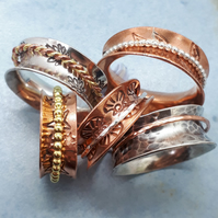 Patterned silver or copper spinner ring