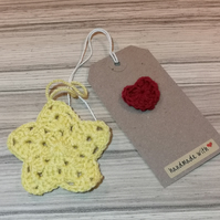 Beautiful yellow Christmas star decoration with gift tag