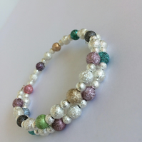 Memory Wire bracelet with silver plated multi coloured stardust beads