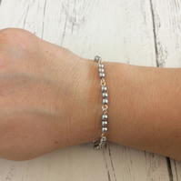 Handmade bracelet with silver beads and silver wire wraps