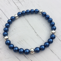 Stretch bracelet with blueberry glass pearl beads and silver plated beads