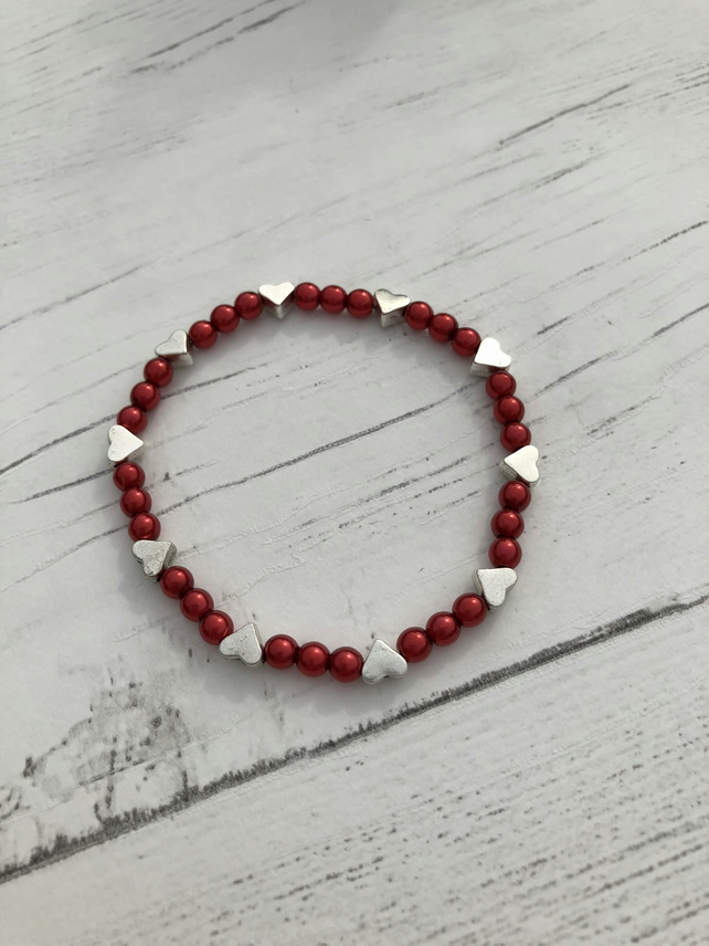 red beads and silver heart beaded handmade stretch bracelet