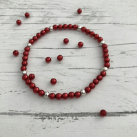 Red preciosa glass pearl beads and silver plated beaded stretch bracelet