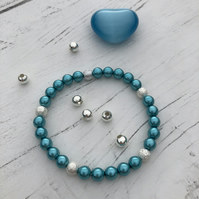 Turquoise preciosa beads and silver plated stardust beaded stretch bracelet