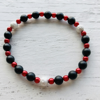 Bracelet with black and red beads with some sparkle