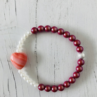 Pink heart stretch bracelet with white and red glass pearl beads