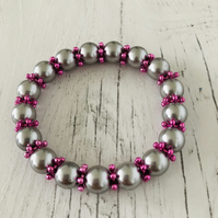 Pink snowflake beads and Silver Czech beads stretch bracelet