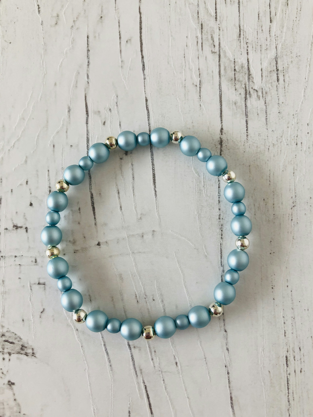 Frosted blue glass pearl beads and silver plated beaded stretch bracelet