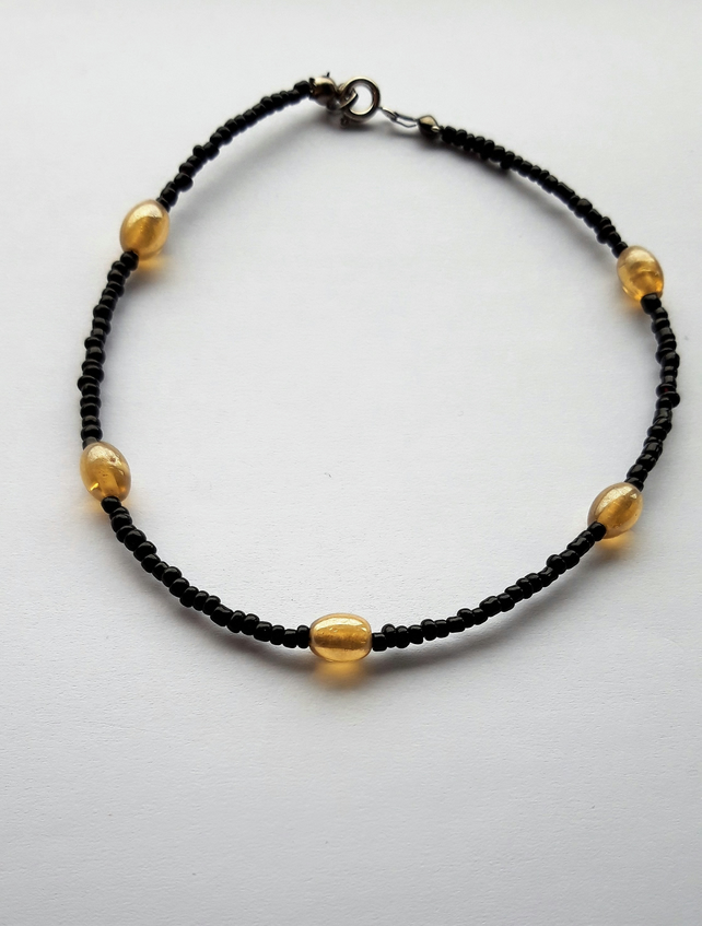 Beautiful Black Beaded Bracelet with Yellow Beads Embellishments