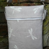 A Lined Cross Body Bag Featuring Dragonflies
