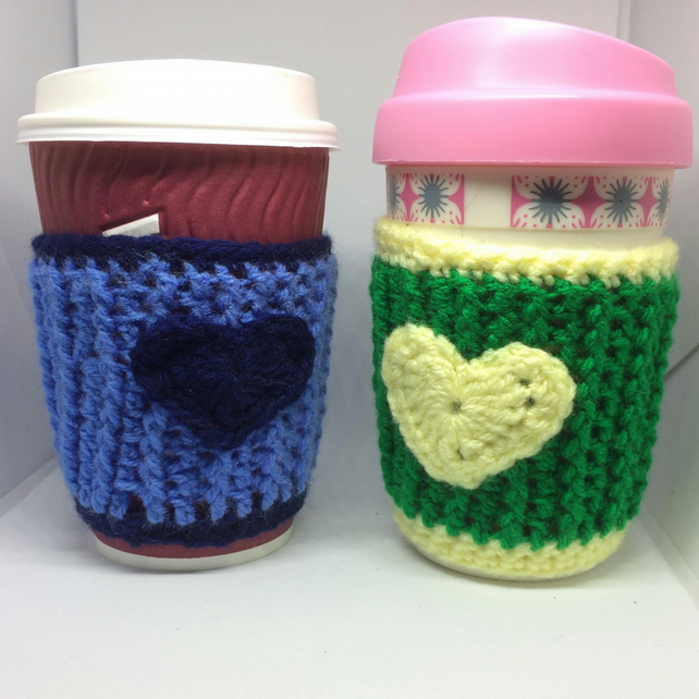 Crocheted heart coffee cup cosy