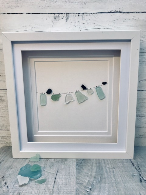 Framed sea glass art-washing line