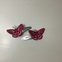 Pink embroidered butterfly's on silver hair clips