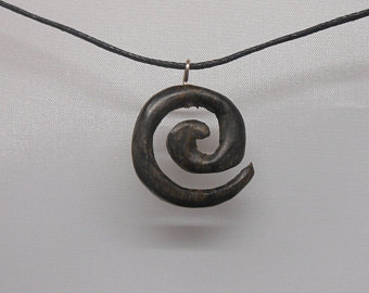 Small spiral pendant made from genuine bog oak