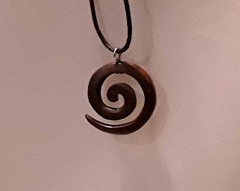 Small spiral pendant made from reclaimed rosewood