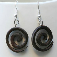 Small spiral earrings made from reclaimed rosewood