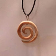 Small spiral pendant made from reclaimed Ash