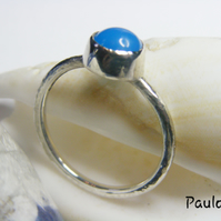 Handmade Sterling Silver with blue agate cabochon. Hammered finish.