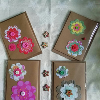 Set of four floral note cards.