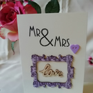 Elegant ivory wedding card, with wooden embellishments