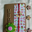 Mother's day card, with wooden letters and a felt flower.