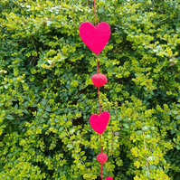 Red felt heart hanging garland.